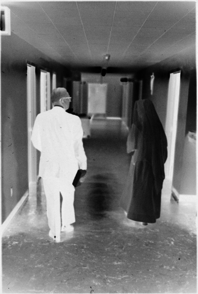 Untitled (Dr. Herman M. Juergens And Nun Walking Down Hallway)