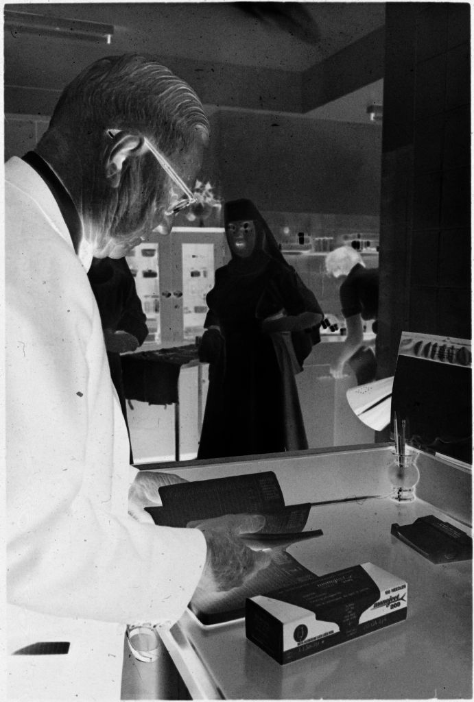Untitled (Dr. Herman M. Juergens And Nun In Office)