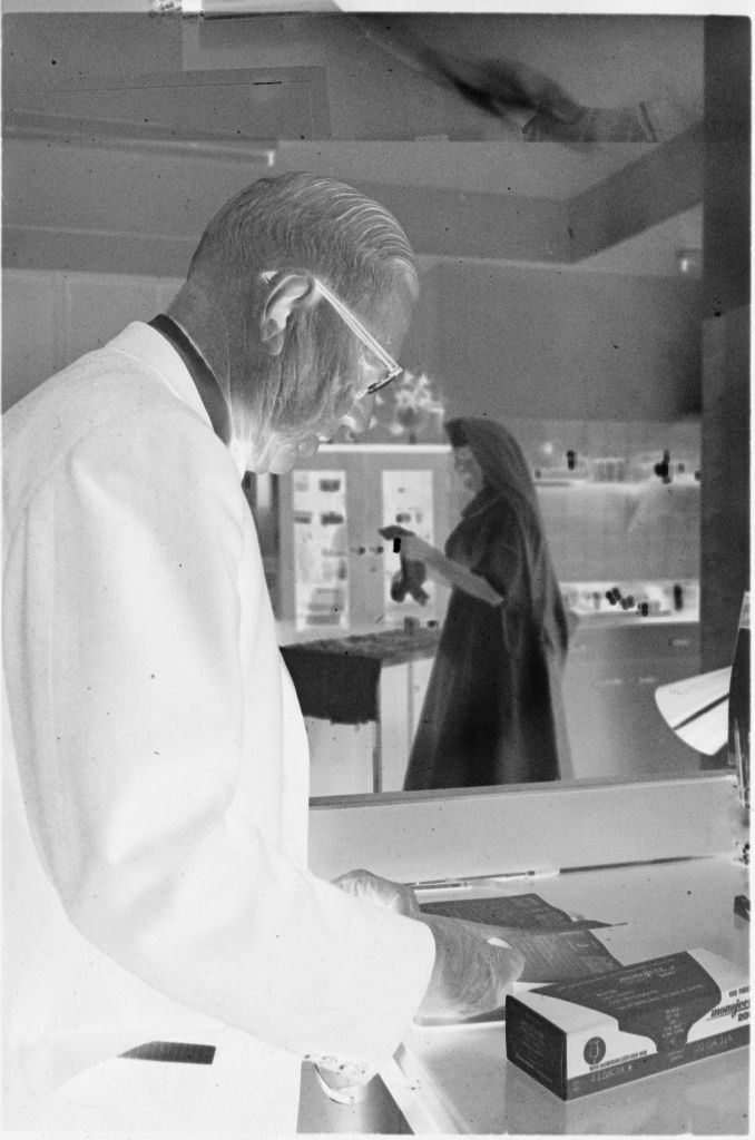 Untitled (Dr. Herman M. Juergens And Nun In Work Area)