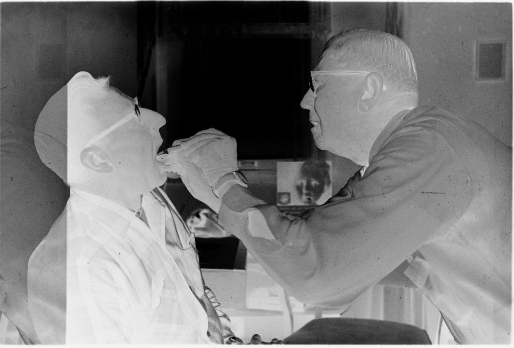 Untitled (Dr. Herman M. Juergens Examining Inside Of Patient's Mouth)