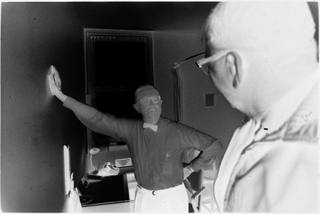 Untitled (Dr. Herman M. Juergens Talking With Patient In Exam Room)