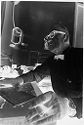 Untitled (Dr. Herman M. Juergens At Desk In Office Talking With Unseen Person)