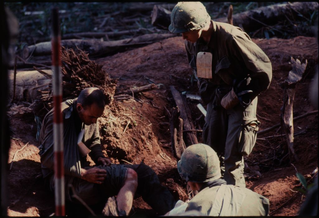 Untitled (Wounded Soldier Examining Injured Leg, Central Highlands Near Dak To, Vietnam)