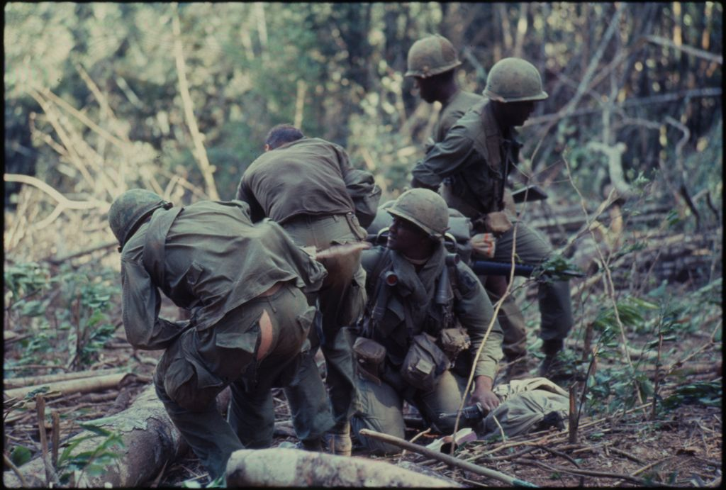 Untitled (Soldiers In Line Pulling Equipment Through Jungle, Central Highlands Near Dak To, Vietnam)