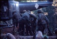 Untitled (soldiers boarding helicopter following battle for Hill 882, central highlands near Dak To, Vietnam)