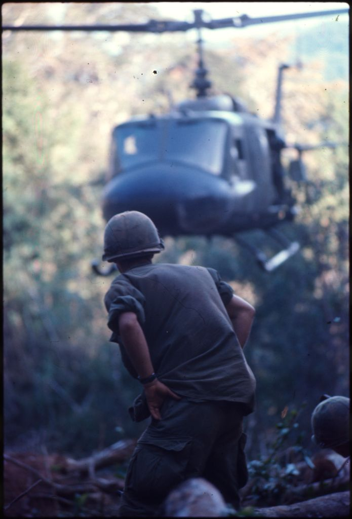 Untitled (Soldiers In Clearing Near Top Of Hill 882 Watching Arrival Of Helicopter, Central Highlands Near Dak To, Vietnam)