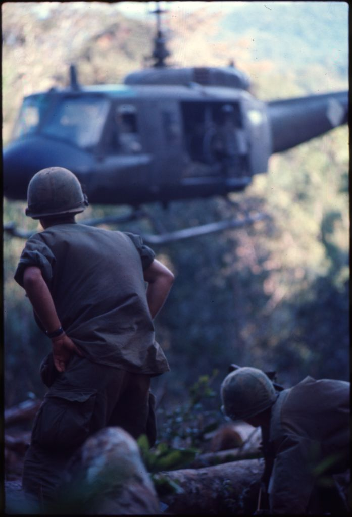 Untitled (Soldiers At Hilltop Landing Zone Watching Arrival Of Helicopter, Vietnam)
