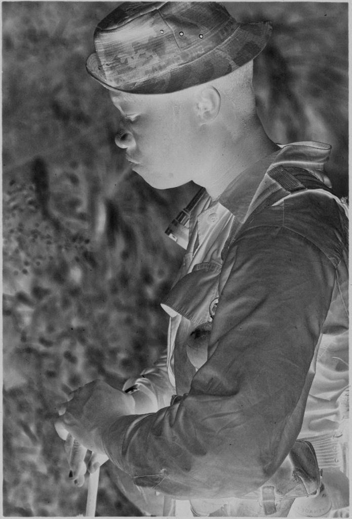 Untitled (Soldier Resting Along Roadside During Patrol, Vietnam)