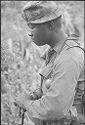Untitled (Soldier Resting Along Roadside During Patrol, Vietnam)