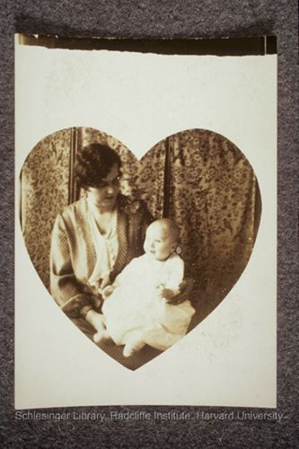A mother and infant in a heart-shaped photo.