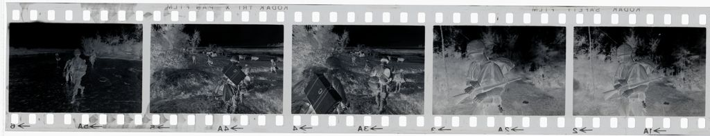 Untitled (Soldiers Carrying Supplies Across Field, Vietnam)