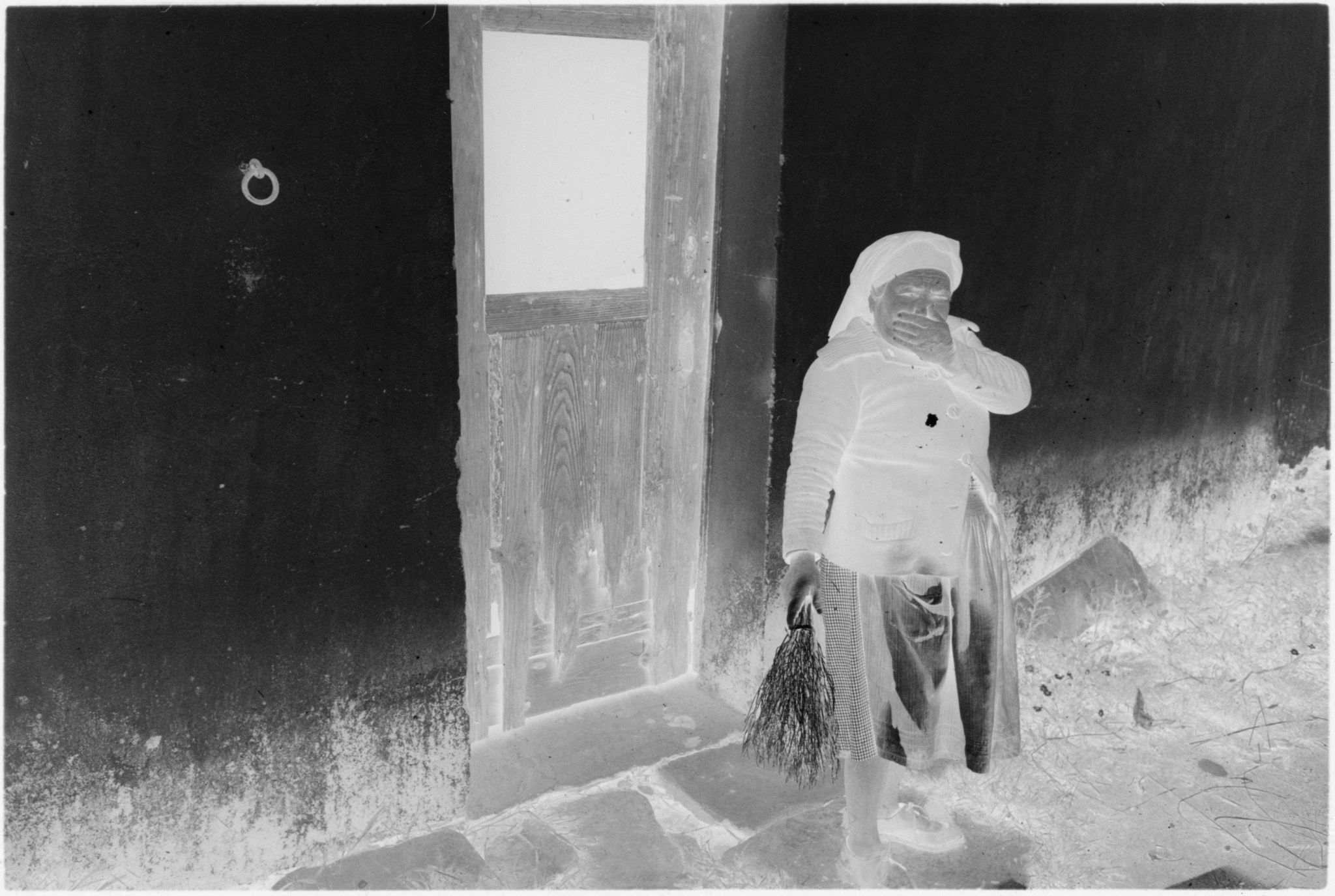 Untitled (Old Woman Standing Outside Building)