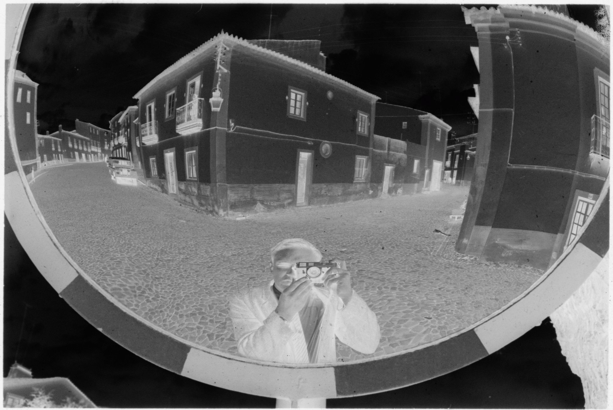 Untitled (Reflection Of Gordon Gahan And The Intersection Of Stone Streets In Convex Mirror, Nazaré, Portugal)