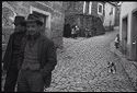 Untitled (Men Walking Down Cobblestone Street, Nazaré, Portugal)