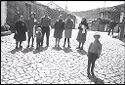 Untitled (Family Standing In Cobblestone Square, Nazaré, Portugal)