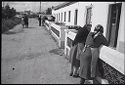 Untitled (Two Women Leaning Against Rail Outside Houses, Nazaré, Portugal)