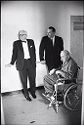 Untitled (Two Doctors With Patient In Wheelchair In Hallway)
