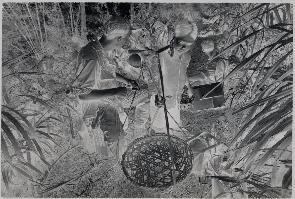 Untitled (Soldiers Resting On Path And Civilian Woman Hanging Large Basket, Vietnam)