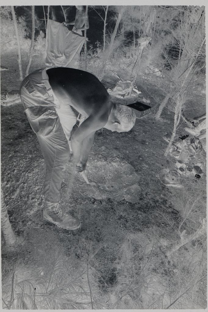 Untitled (Soldier Digging Hole In Small Clearing, Vietnam)