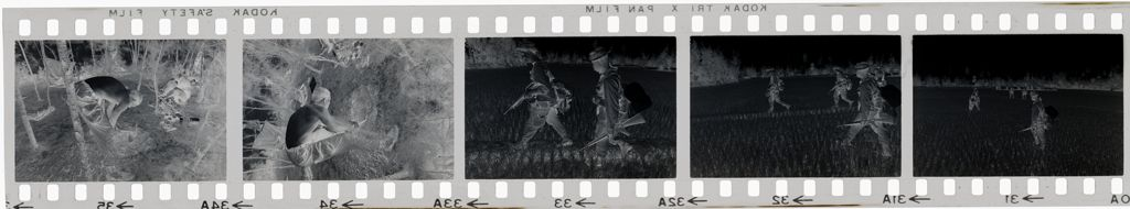Untitled (Soldiers Walking Through Rice Paddy; Taking Break In Clearing, Vietnam)