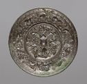 Circular Mirror With Relief Decoration Of Lions, Birds, And Other Animals Against A Fruiting Grapevine Arabesque