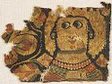 Fragments Of A Textile Hanging With Female Busts