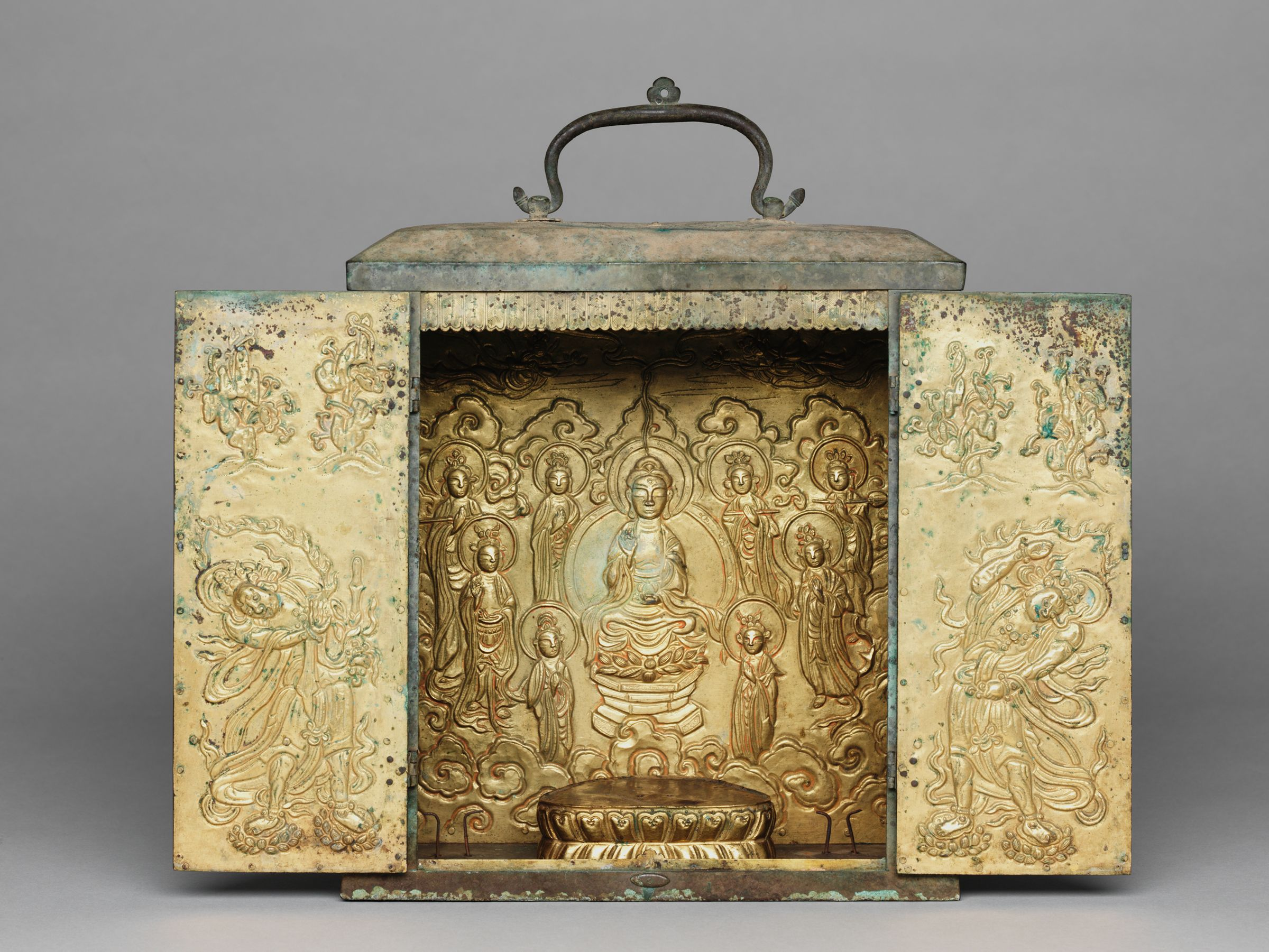 Portable Buddhist Shrine With Two Removable Standing Bodhisattvas, A Lotus Base For A Seated Buddha Image (Now Missing), A Repoussé Panel Depicting The Buddha Amitabha (Amit'abul), And Repoussé Panels On The Doors Representing Guardian Figures
