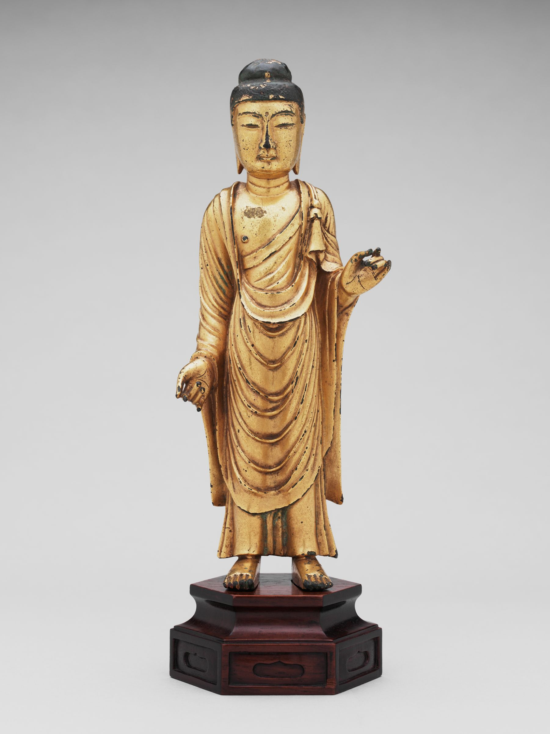 Standing Buddha With Right Hand Lowered And With Left Hand Raised