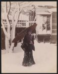Work 3 of 53 Title: Woman wearing winter clothing and holdin... Date: ca. 1890
