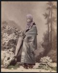 Work 4 of 53 Title: Woman wearing winter clothing and holdin... Date: ca. 1890