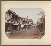 Work 28 of 50 Title: Street scene, with shops and paper lante... Date: ca. 1890