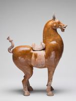 Standing Saddled Horse With Clipped Mane, Cropped And Tied Tail, And Roman-Style Bridle Ornaments