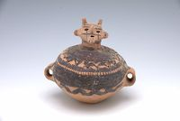 Small Covered Jar With Two Lug Handles And With Geometric Decor, The Cover In The Form Of A Human Head