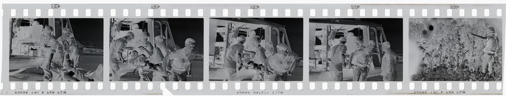 Untitled (Members Of 57Th Medical Detachment Taking Wounded Soldier Out Of Medevac Helicopter, Vietnam)