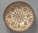 Bowl With Radial Foliate Design