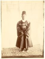 Portrait Photograph Of King Ko-Chong Wearing Royal Robes And Standing On A Carpet