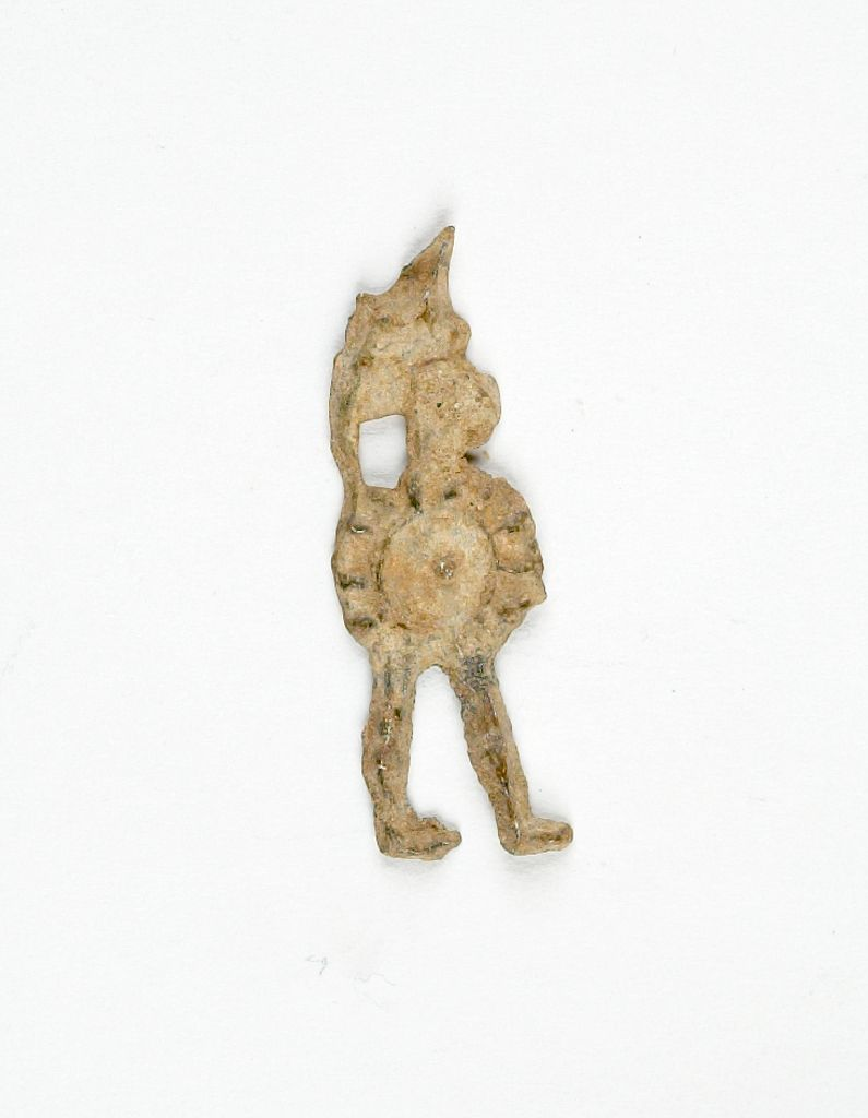 Votive Figure Of A Warrior With Helmet And Shield