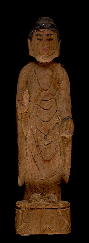 Small Image Of Medicine Buddha Bhaisajyaguru (Japanese: Yakushi Nyorai) Holding Jar In Left Hand