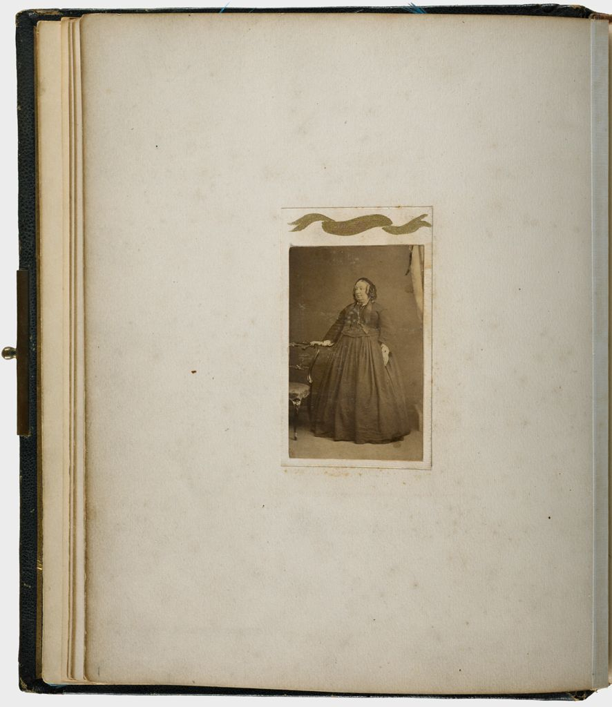 Untitled (Verso: Albumen Silver Print Carte De Visite Photograph, Full-Length Of Woman, Right Hand Resting On Back Of Chair, Labeled Phatty)