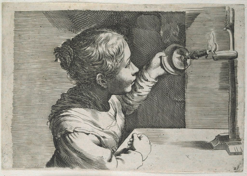 A Girl Lighting A Lamp