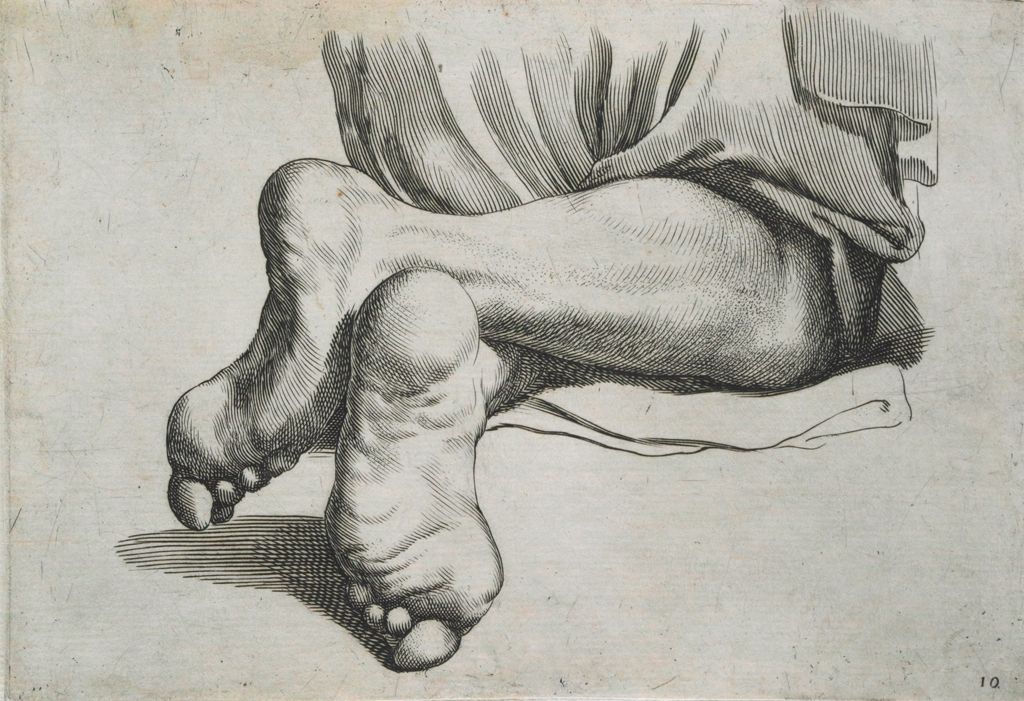 Two Legs Of A Man In A Kneeling Position