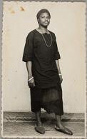 Untitled (studio portrait, man with necklace and bracelet)