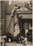 Untitled (Jessie Tarbox Beals preparing to take photograph atop high ladder, main entrance of the Austrian Pavilion, 1904 St. Louis World's Fair)