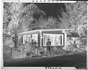 Untitled (Man With Fishing Pole In Front Of Small House)