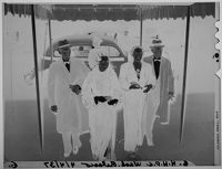 Untitled (Two Couples Under Awning, Hasty Pudding Tour)