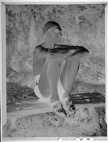 Untitled (Man In Swim Cap And Bathing Suit Sitting On A Bench)