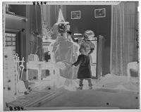 Untitled (Two Young Children Playing With Halloween Jack O' Lantern)