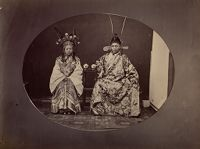 Woman And Man Posing In Chinese Opera Costumes