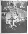 Untitled (Woman Riding An Elephant Posed With Clown In Front Of Circus Trailer)