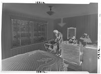 Untitled (Woman In Bedroom Tending To Baby On Changing Table)